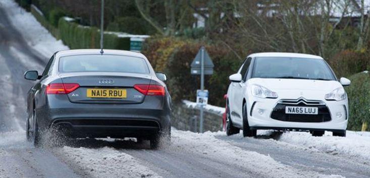 cars struggling in snow