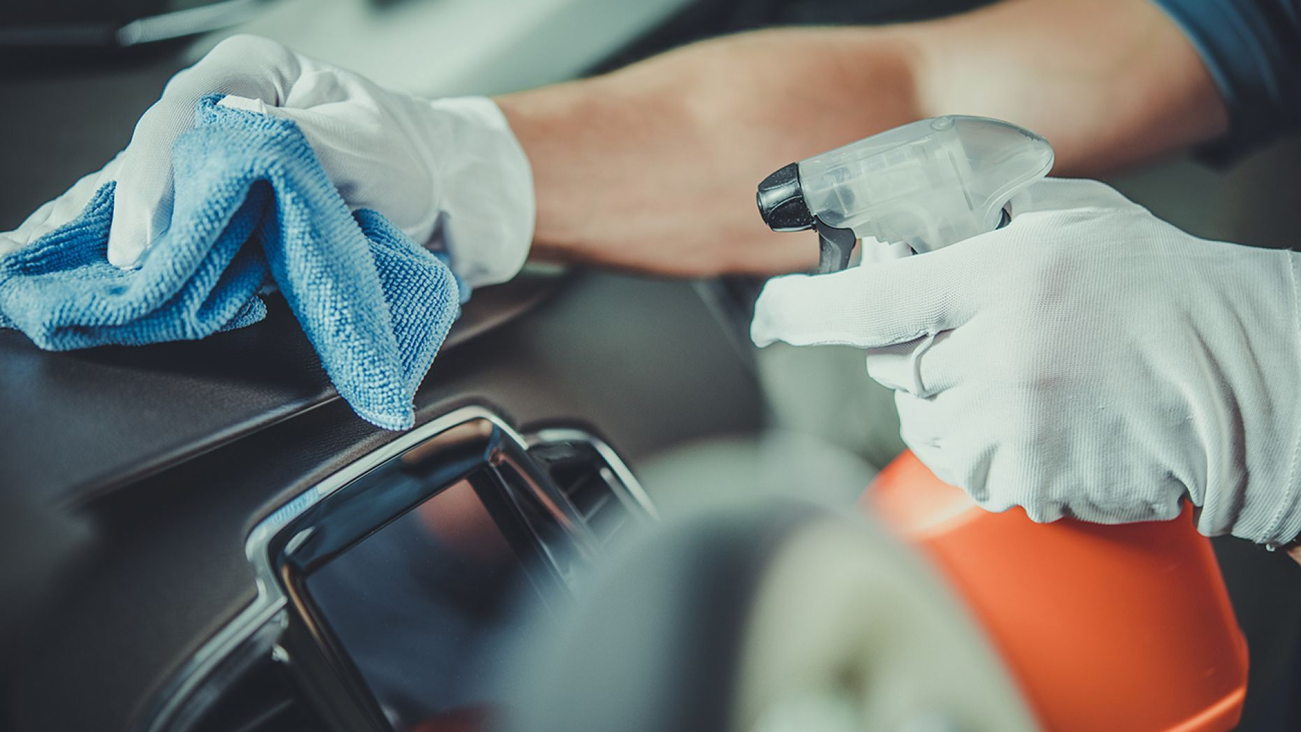 Cleaning car wearing gloves